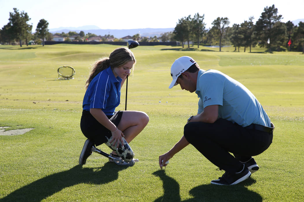 Defending champion Patrick Cantlay, right, with patient Maleah Johnson, 16, get ready to hit a marshmallow during the Shriners Hospitals for Children Open media day at TPC Summerlin golf course in ...