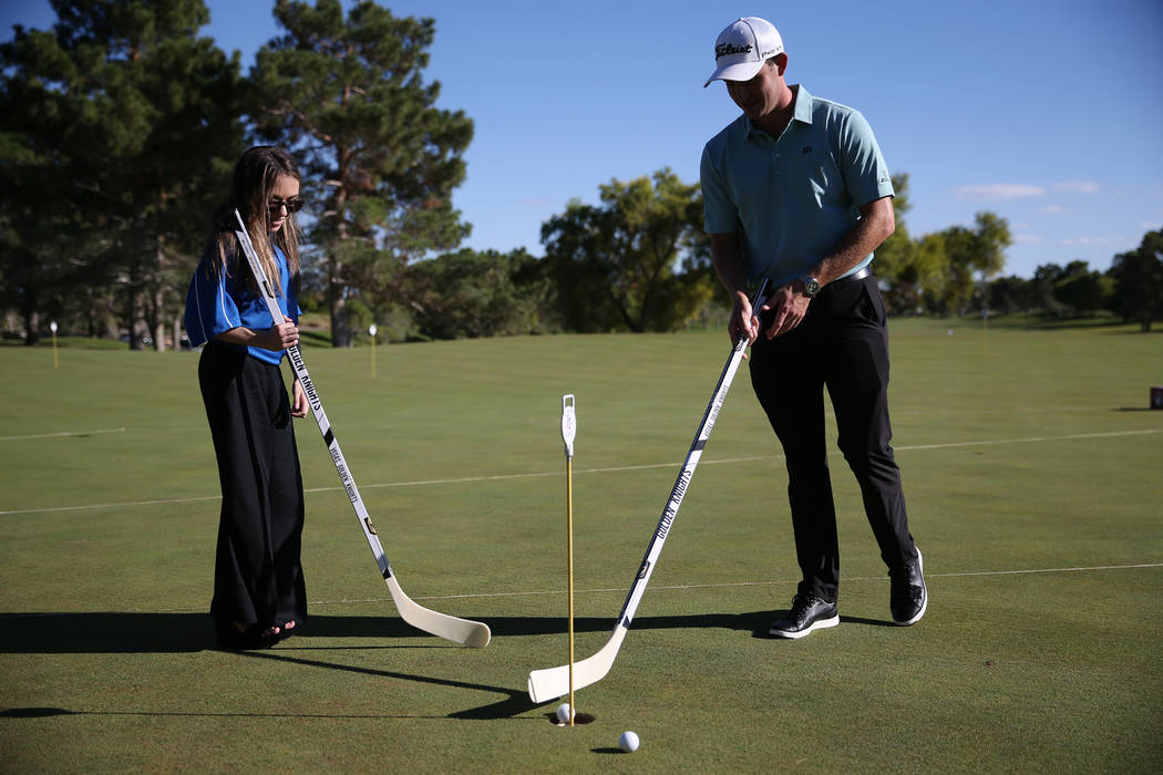 Defending champion Patrick Cantlay, right, with patient Taylor Halbert, 16, during the Shriners Hospitals for Children Open media day at TPC Summerlin golf course in Las Vegas, Friday, Oct. 12, 20 ...