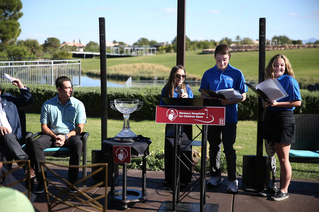 Defending champion Patrick Cantlay, from left, with patients Taylor Halbert, 16, Cristian Gray, 17, and Maleah Johnson, 16, attend the Shriners Hospitals for Children Open media day at TPC Summerl ...