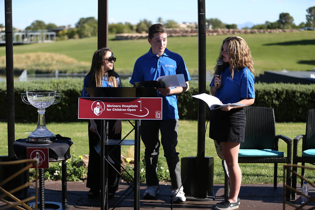 Patients Taylor Halbert, 16, from left, Cristian Gray, 17, and Maleah Johnson, 16, attend the Shriners Hospitals for Children Open media day at TPC Summerlin golf course in Las Vegas, Friday, Oct. ...