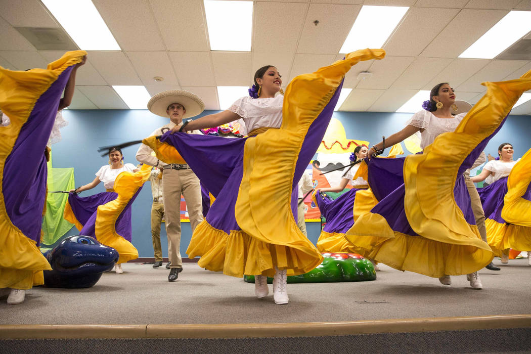 Members of the Sunrise Mountain High Ballet Folklorico perform for students and staff during a Hispanic Heritage Month event at Wendell P. Williams Elementary School in Las Vegas on Friday, Oct. 1 ...