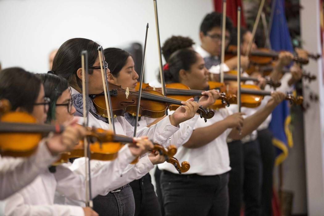 Members of the Mariachi Perla Del Oeste perform for students and staff during a Hispanic Heritage Month event at Wendell P. Williams Elementary School in Las Vegas on Friday, Oct. 12, 2018. Richar ...