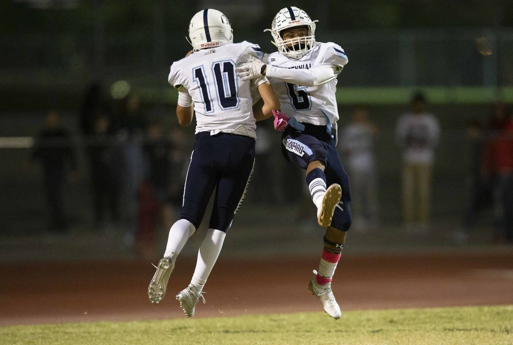 Centennial's Gerick Robinson (6) celebrates his touchdown with quarterback Colton Tenney (10) during the first half of a varsity football game against Palo Verde at Palo Verde High School in Las V ...