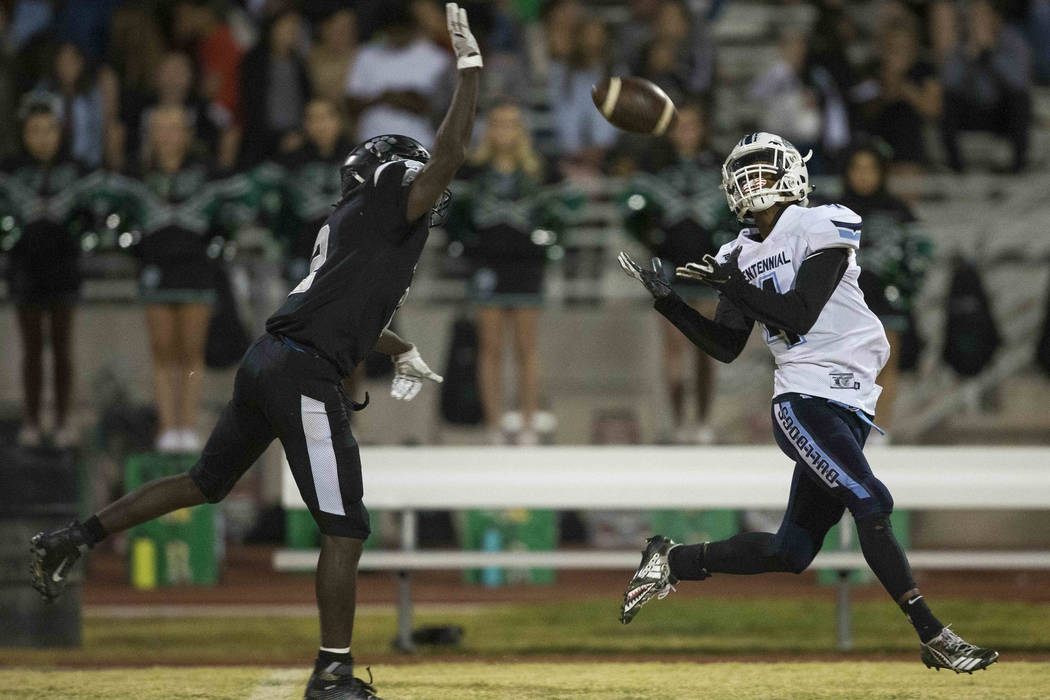 Centennial wide receiver Aaron Johnson (4) makes a catch for a touchdown over Palo Verde's Charron Thomas (2) during the second half of a varsity football game at Palo Verde High School in Las Veg ...