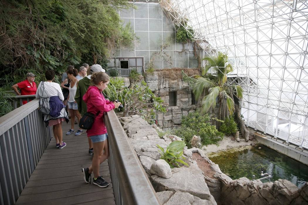 Tourists check out the Biosphere 2 Ocean, holding a million gallons of seawater, designed as an enclosed ecological system to research interactions within ecosystems, in Oracle, Ariz., in 2015. (A ...