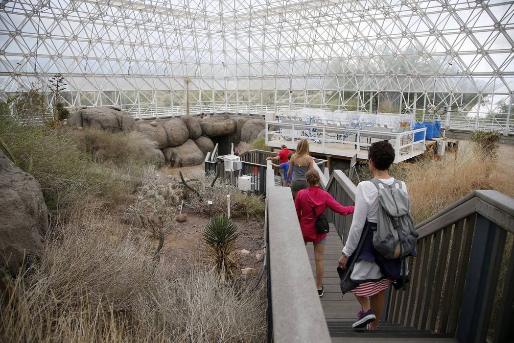 Tourists walk through the enclosed coastal fog desert ecosystem of the Biosphere 2 in Oracle, Ariz., in 2015. (AP Photo/Ross D. Franklin)