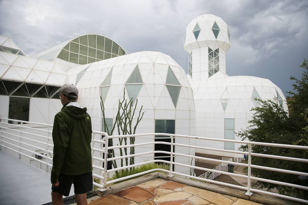 A tourist walks to the main entrance of the Biosphere 2 facility while on a walking tour in Oracle, Ariz., in 2015. (AP Photo/Ross D. Franklin)
