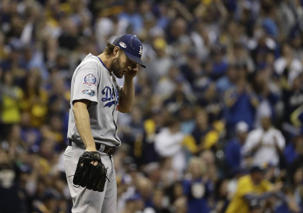 Los Angeles Dodgers starting pitcher Clayton Kershaw reacts during the fourth inning of Game 1 of the National League Championship Series baseball game against the Milwaukee Brewers Friday, Oct. 1 ...