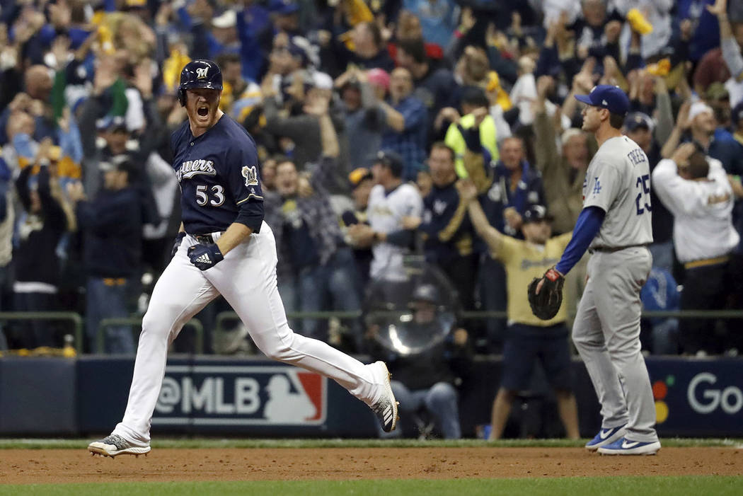 Milwaukee Brewers' Brandon Woodruff (53) celebrates after hitting a home run during the third inning of Game 1 of the National League Championship Series baseball game against the Los Angeles Dodg ...