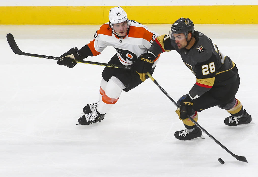 Golden Knights left wing William Carrier (28) moves the puck past Philadelphia Flyers center Nolan Patrick (19) during the third period of a season-opening game at T-Mobile Arena in Las Vegas on T ...