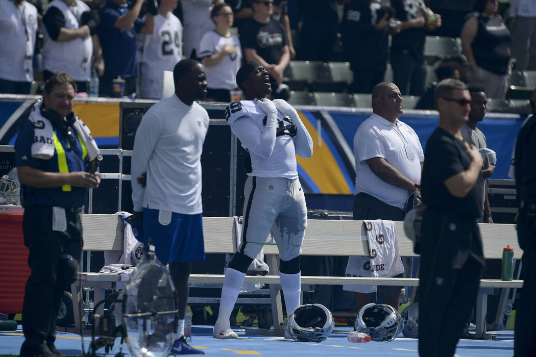 Oakland Raiders wide receiver Amari Cooper reacts during the national anthem before an NFL football game against the Los Angeles Chargers Sunday, Oct. 7, 2018, in Carson, Calif. (AP Photo/Mark J. ...