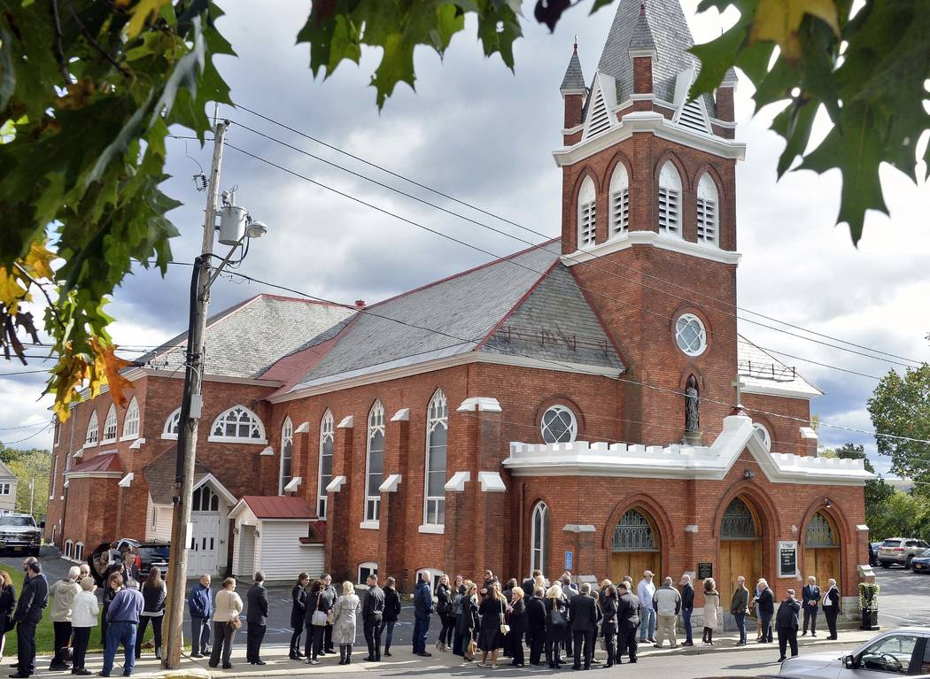 """Mourners enter St. Stanislaus Roman Catholic Church to attend calling hours for Schoharie limo crash victims; Abigail (King) Jackson, Adam """"Action"""" Jackson, Mary (King) Dyson, Robert J. ..."""