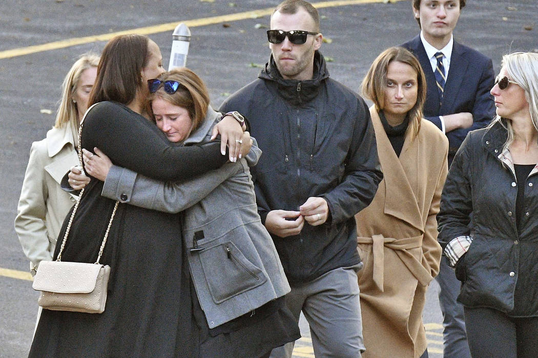 """Mourners leave St. Stanislaus Roman Catholic Church during calling hours for Schoharie limo crash victims; Abigail (King) Jackson, Adam """"Action"""" Jackson, Mary (King) Dyson, Robert J. Dys ..."""