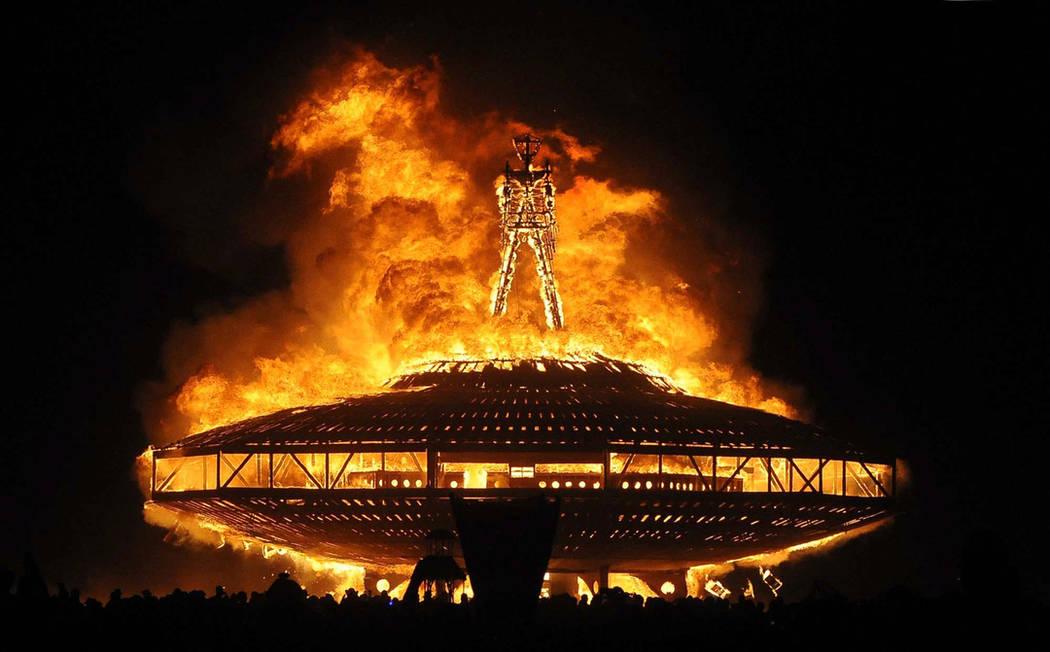 "The ""Man"" burns on the Black Rock Desert at Burning Man near"
