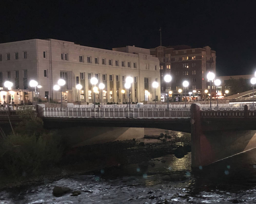 The old Post Office, left, built in downtown Reno on the banks of the Truckee River in 1933, is pictured in this photo taken Sept. 26, 2018. (AP Photo/Scott Sonner)