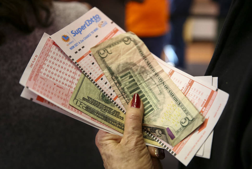 A woman waits to buy lottery tickets at The Lotto Store at Primm just inside the California border next to the Primm Valley Casino Resorts on Friday, January 5, 2018. (Richard Brian Las Vegas Revi ...