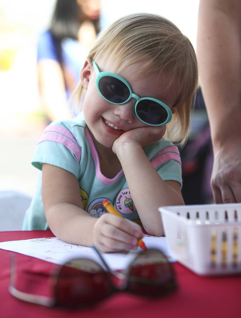 Three-year-old Charlie Wall works on a drawing for the Review-Journal coloring contest during the 23rd annual Summerlin Festival of Arts at Downtown Summerlin in Las Vegas on Saturday, Oct. 13, 20 ...