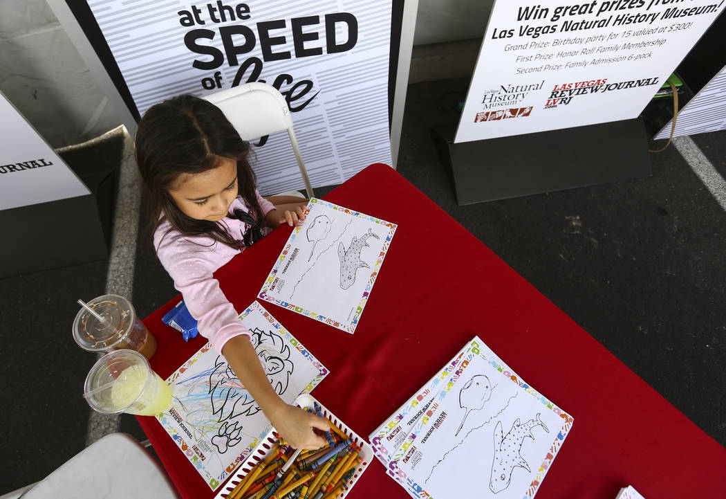 Sophia Rivera, 7, works on a drawing for the Review-Journal coloring contest during the 23rd annual Summerlin Festival of Arts at Downtown Summerlin in Las Vegas on Saturday, Oct. 13, 2018. Chase ...