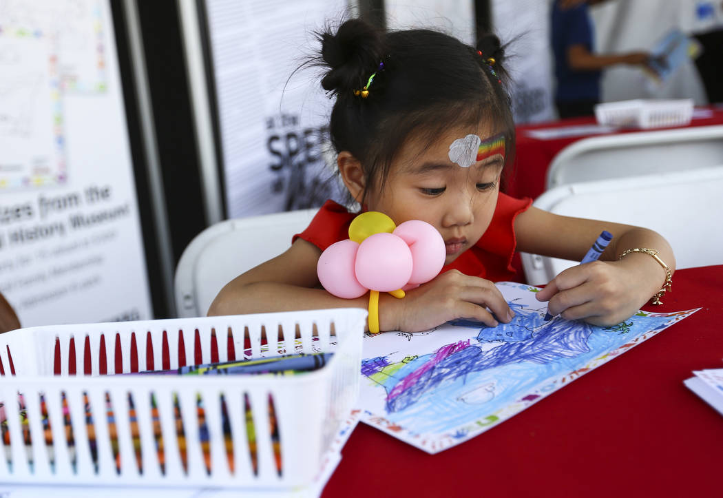 Victoria To, 5, works on a drawing for the Review-Journal coloring contest during the 23rd annual Summerlin Festival of Arts at Downtown Summerlin in Las Vegas on Saturday, Oct. 13, 2018. Chase St ...