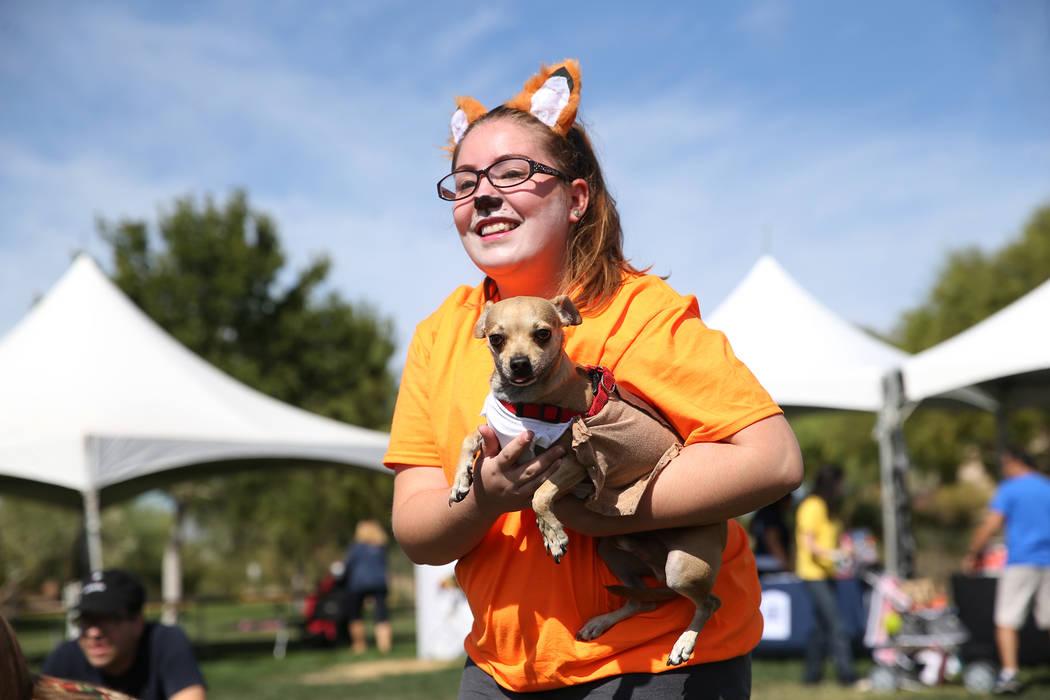Hannah Straczek, 17, with her dog Pepe, attend the Family, Fur & Fun Festival at Exploration Park in Las Vegas, Saturday, Oct. 13, 2018. Erik Verduzco Las Vegas Review-Journal @Erik_Verduzco