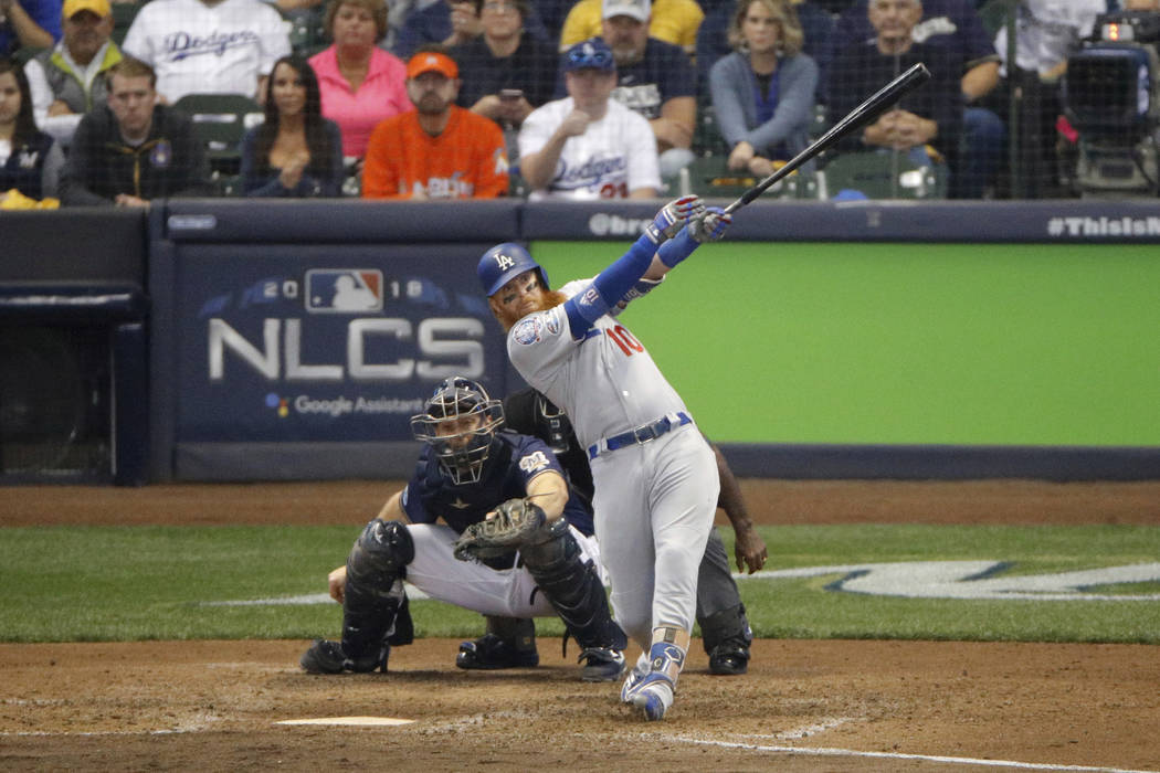Los Angeles Dodgers' Justin Turner (10) hits a two-run home run during the eighth inning of Game 2 of the National League Championship Series baseball game against the Milwaukee Brewers Saturday, ...