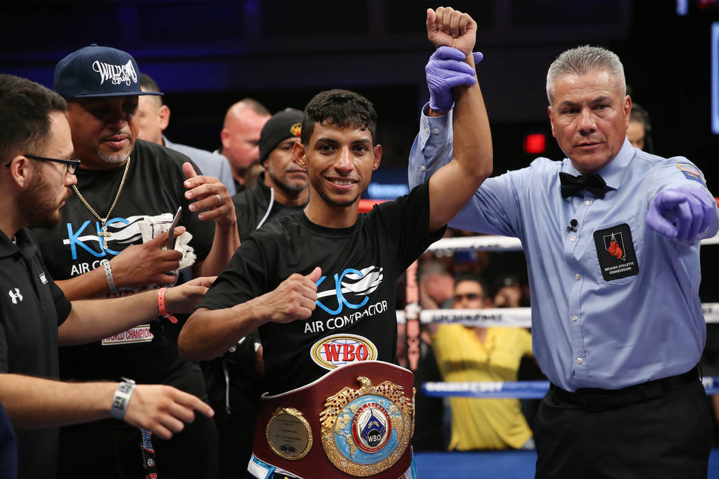 Angel Acosta celebrates his second round knockout win against Abraham Rodriguez in the second round of the WBO lightweight title bout at the Hard Rock hotel-casino in Las Vegas, Saturday, Oct. 13, ...