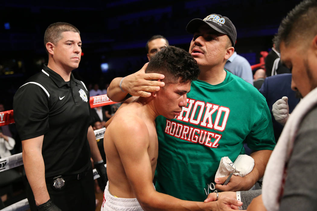 Abraham Rodriguez is comforted by his team after getting knocked out in the second round of the WBO lightweight title bout at the Hard Rock hotel-casino in Las Vegas, Saturday, Oct. 13, 2018. Erik ...