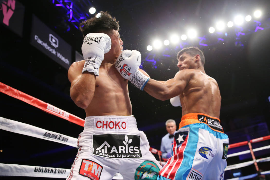 Angel Acosta, right, connects a punch to knockout Abraham Rodriguez in the second round of the WBO lightweight title bout at the Hard Rock hotel-casino in Las Vegas, Saturday, Oct. 13, 2018. Erik ...