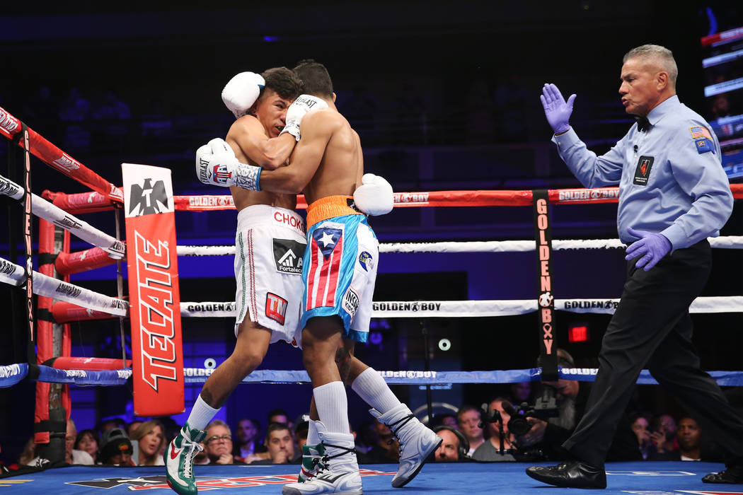 Abraham Rodriguez, left, battles Angel Acosta in the first round of the WBO lightweight title bout at the Hard Rock hotel-casino in Las Vegas, Saturday, Oct. 13, 2018. Erik Verduzco Las Vegas Revi ...