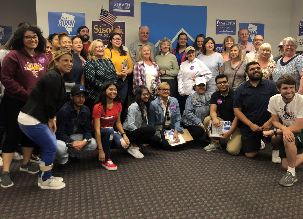 Nevada Democratic party campaign volunteers pose for a photo with DNC chairman Tom Perez and vice chair Grace Meng, Democratic gubernatorial candidate Steve Sisolak and Rep. Dina Titus at a canvas ...