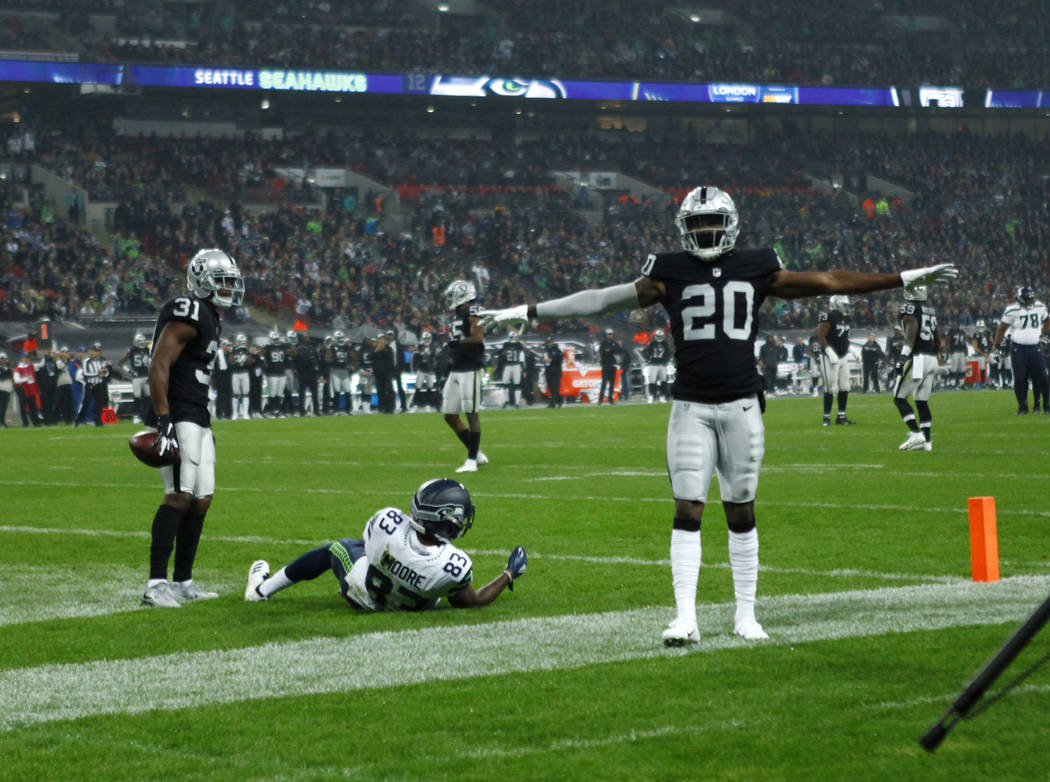 Oakland Raiders cornerback Daryl Worley (20) and Oakland Raiders strong safety Marcus Gilchrist (31) celebrate in the end zone after breaking up a pass intended for Seattle Seahawks wide receiver ...