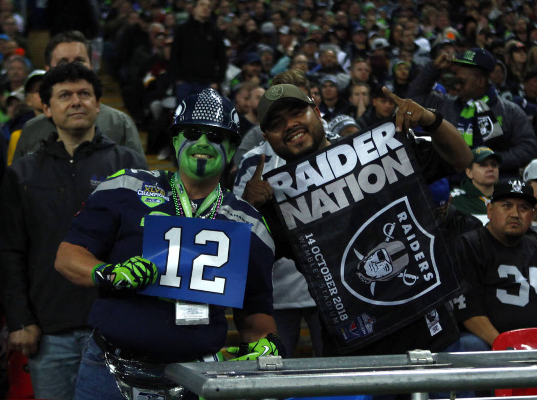 A Seattle Seahawks fan and Oakland Raiders fan pose together during the first half of an NFL game at Wembley Stadium in London, England, Sunday, Oct. 14, 2018. Heidi Fang Las Vegas Review-Journal ...