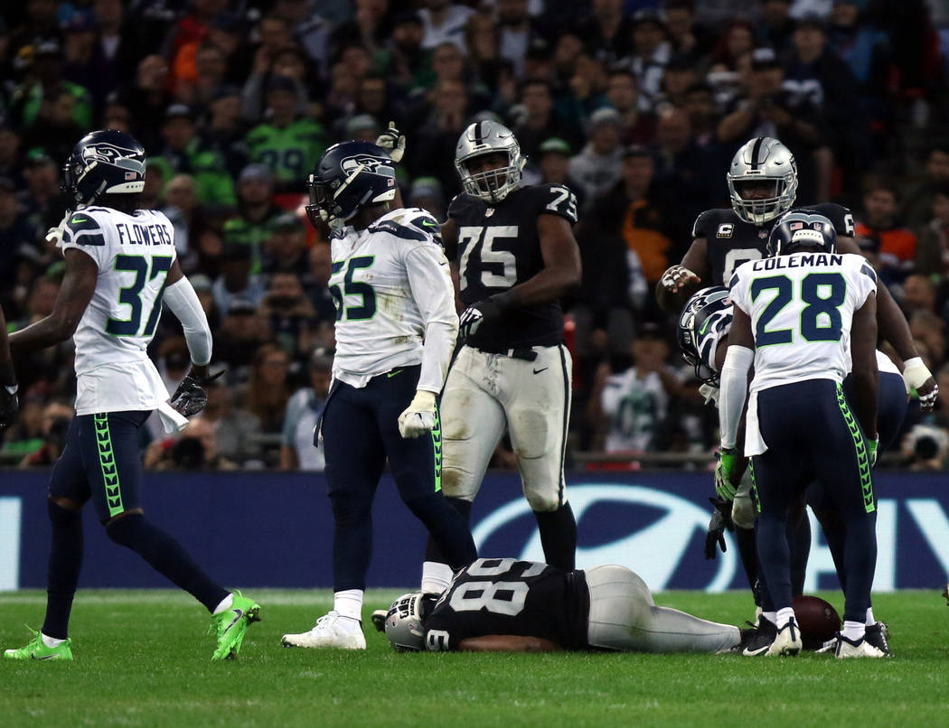 Oakland Raiders wide receiver Amari Cooper (89) lays on the field unconscious after getting hit by Seattle Seahawks strong safety Bradley McDougald (30), not pictured, during the first half of an ...