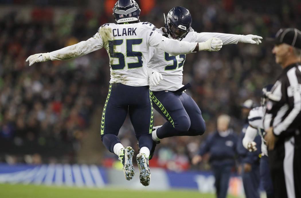 Seattle Seahawks defensive end Frank Clark (55) celebrates with defensive end Branden Jackson (93) after he sacked Oakland Raiders quarterback Derek Carr (4) during the first half of an NFL footba ...