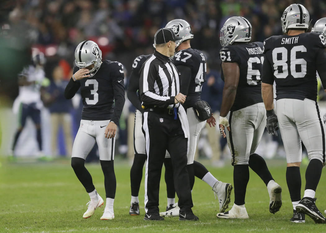 Oakland Raiders kicker Matt McCrane (3), left, reacts after missing a field goal during the first half of an NFL football game against Seattle Seahawks at Wembley stadium in London, Sunday, Oct. 1 ...