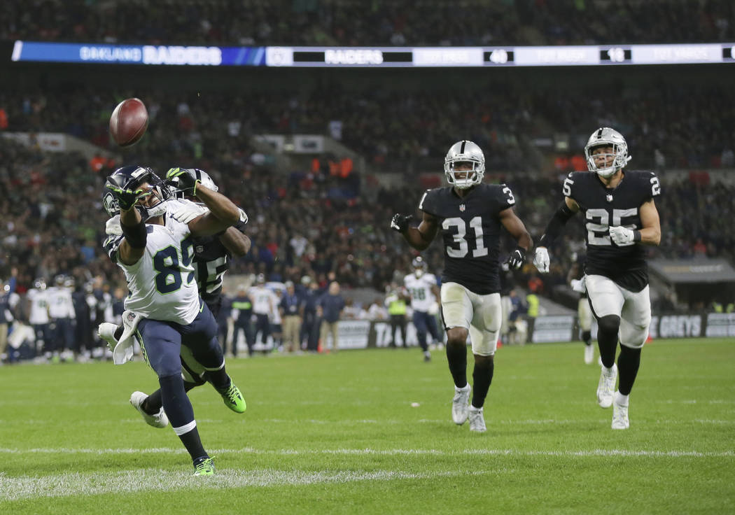 Seattle Seahawks wide receiver Doug Baldwin (89) stretches but fails to catch a pass during the first half of an NFL football game against Oakland Raiders at Wembley stadium in London, Sunday, Oct ...