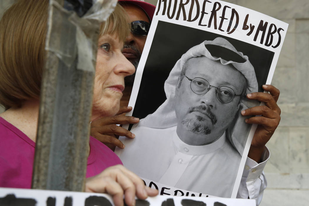 People hold signs during a protest on Wednesday at the Embassy of Saudi Arabia about the disappearance of Saudi journalist Jamal Khashoggi, in Washington. The Trump administration's ongoing cour ...
