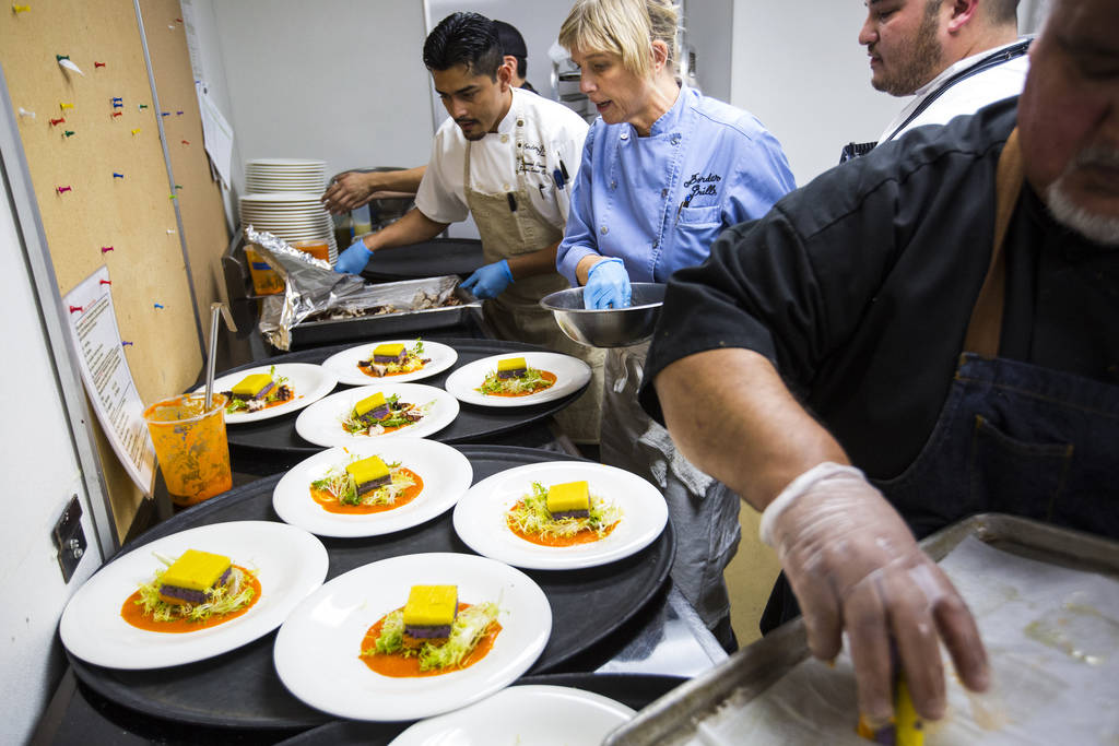 Chef Mary Sue Milliken prepares the 3rd course dish during the James Beard Foundation's Celebrity Chef tour dinner series at the Velvet Room at Luxor in Las Vegas on Saturday, Oct. 13, 2018. The d ...