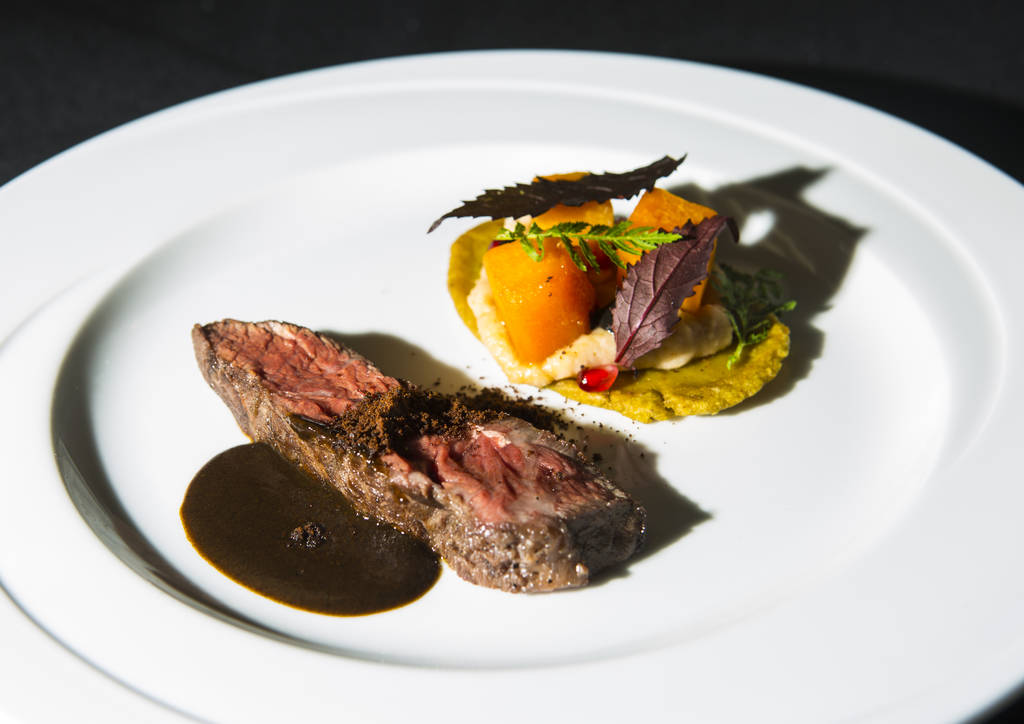 The 6th course dish by Chef Stephan Pyles during the James Beard Foundation's Celebrity Chef tour dinner series at the Velvet Room at Luxor in Las Vegas on Saturday, Oct. 13, 2018. The dish featur ...