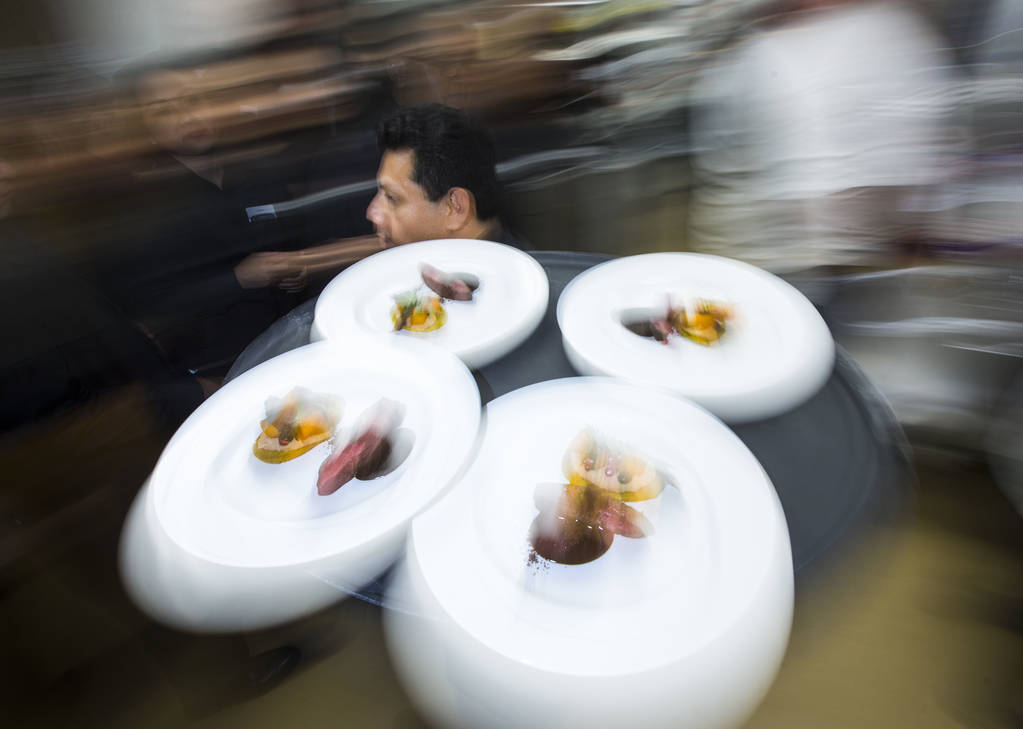 The 6th course dish by Chef Stephan Pyles are taken out to be served during the James Beard Foundation's Celebrity Chef tour dinner series at the Velvet Room at Luxor in Las Vegas on Saturday, Oct ...