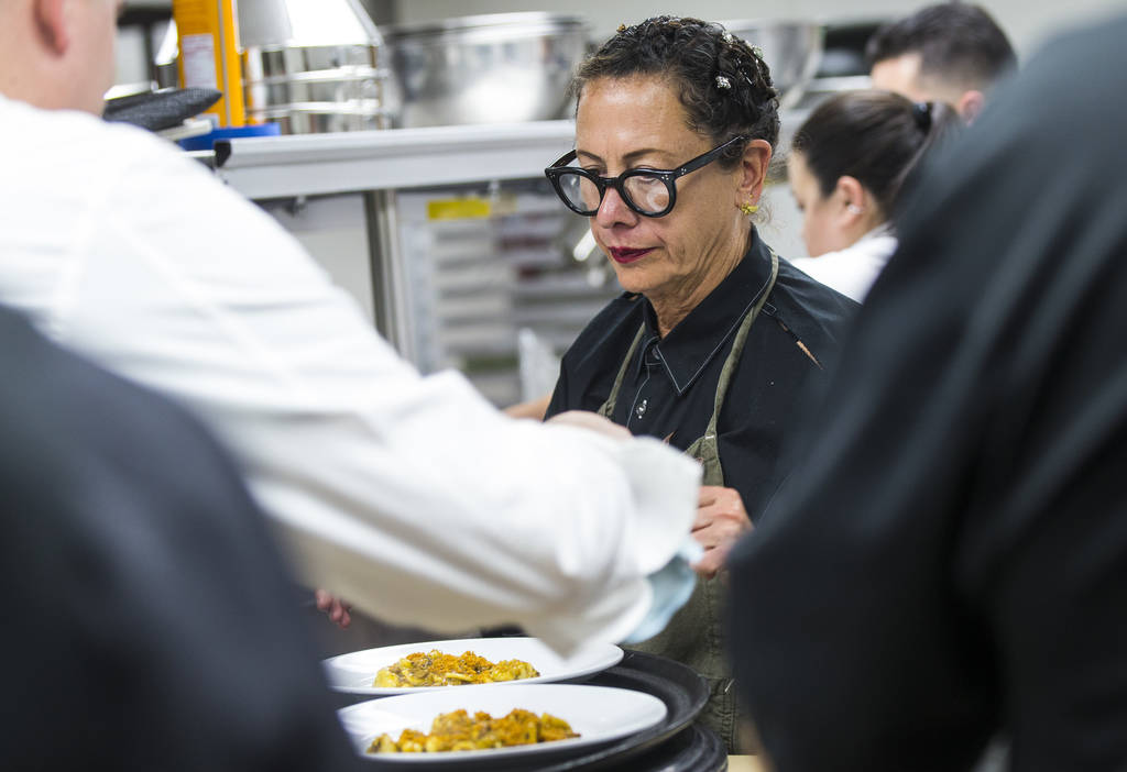 Chef Nancy Silverton prepares plates of the 2nd course dish during the James Beard Foundation's Celebrity Chef tour dinner series at the Velvet Room at Luxor in Las Vegas on Saturday, Oct. 13, 201 ...