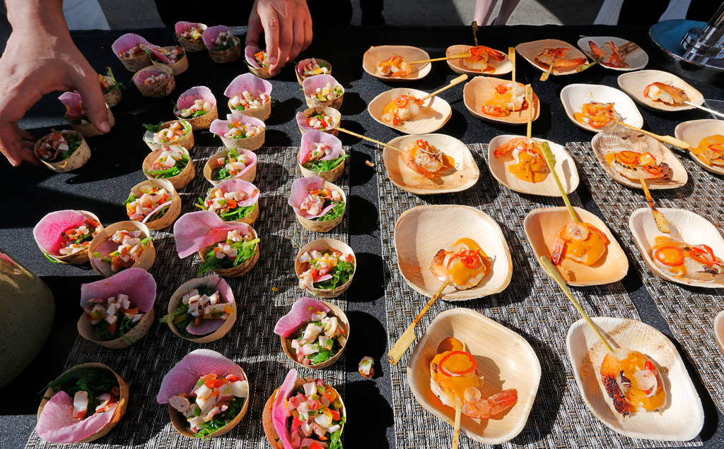 Seaweed & octopus salad, left, and black tiger shrimp are ready for attendees at the tent of OTORO Robata Grill & Sushi during a food event, Martha Stewart Wine & Food Experience, in L ...