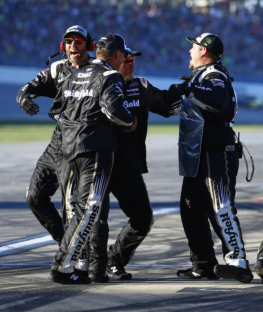 Aric Almirola's crew celebrates after he won the 1000Bulbs.com 500 NASCAR Cup Series auto race at Talladega Superspeedway, Sunday, Oct. 14, 2018, in Talladega, Ala. (AP Photo/Butch Dill)