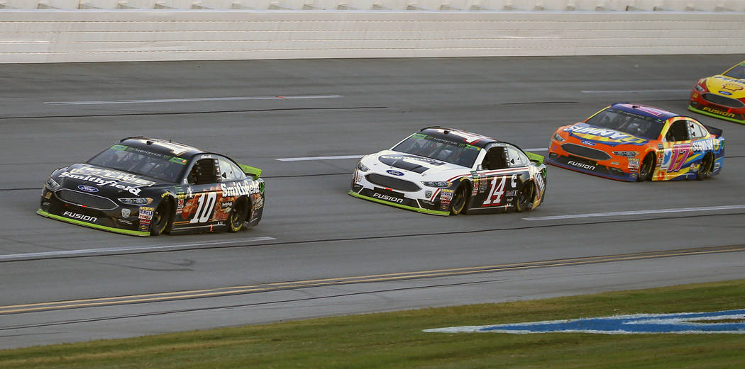 Aric Almirola (10) leads the way to the finish line to win the 1000Bulbs.com 500 NASCAR Cup Series auto race at Talladega Superspeedway, Sunday, Oct. 14, 2018, in Talladega, Ala. (AP Photo/Butch Dill)