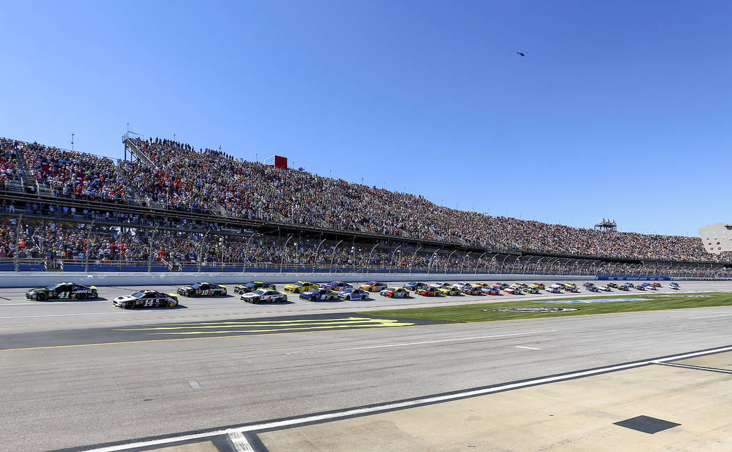 Kurt Busch (41) leads the pack to the start/finish line for the green flag in the 1000Bulbs.com 500 NASCAR Cup Series auto race at Talladega Superspeedway, Sunday, Oct. 14, 2018, in Talladega, Ala ...