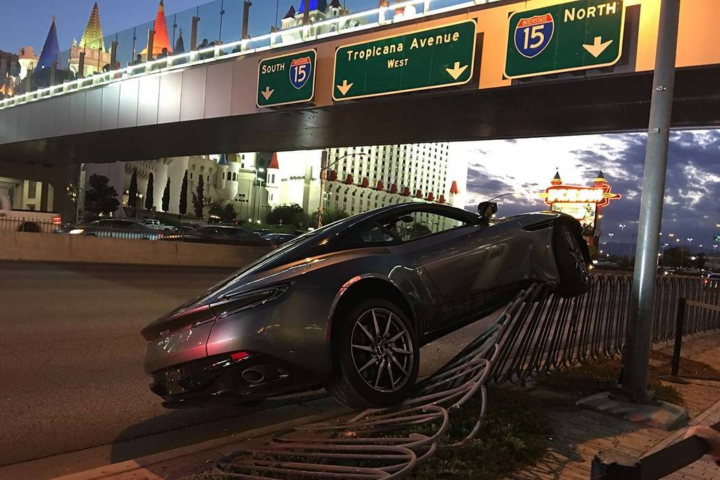 An Aston Martin ran up onto a safety barrier along the Tropicana Avenue west of the Las Vegas Strip Sunday night. (Caitlin Lilly/Las Vegas Review-Journal @caitielilly_)