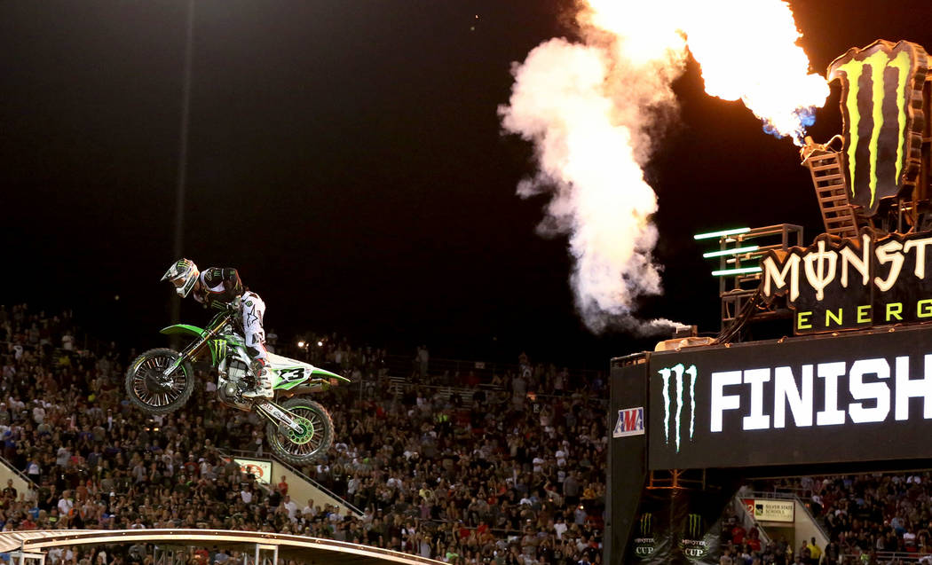 Eli Tomac makes his final jump to win the 2018 Monster Energy Cup Race at Sam Boyd Stadium on Saturday, Oct. 13 , 2018, in Las Vegas. Tomac received a million dollars for winning the race. Bizuaye ...