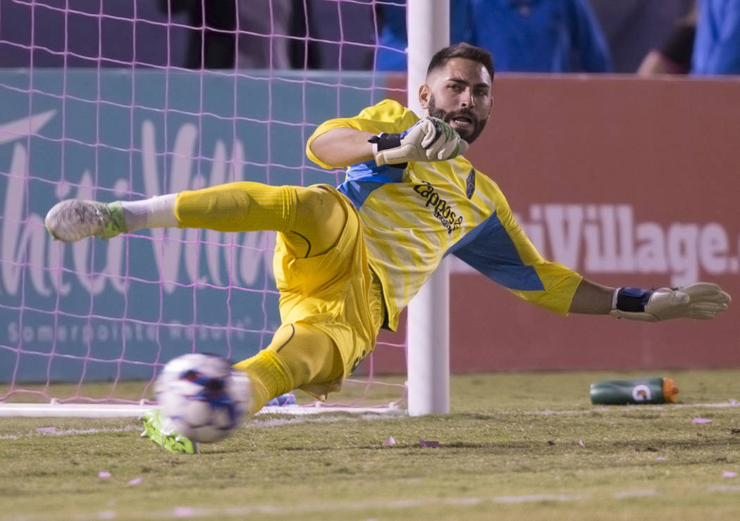 Las Vegas FC goalkeeper Thomas Olsen (30) leaps to try and block a penalty kick in the first half during their United Soccer League game with the Phoenix Rising on Wednesday, Oct. 10, 2018, at Cas ...