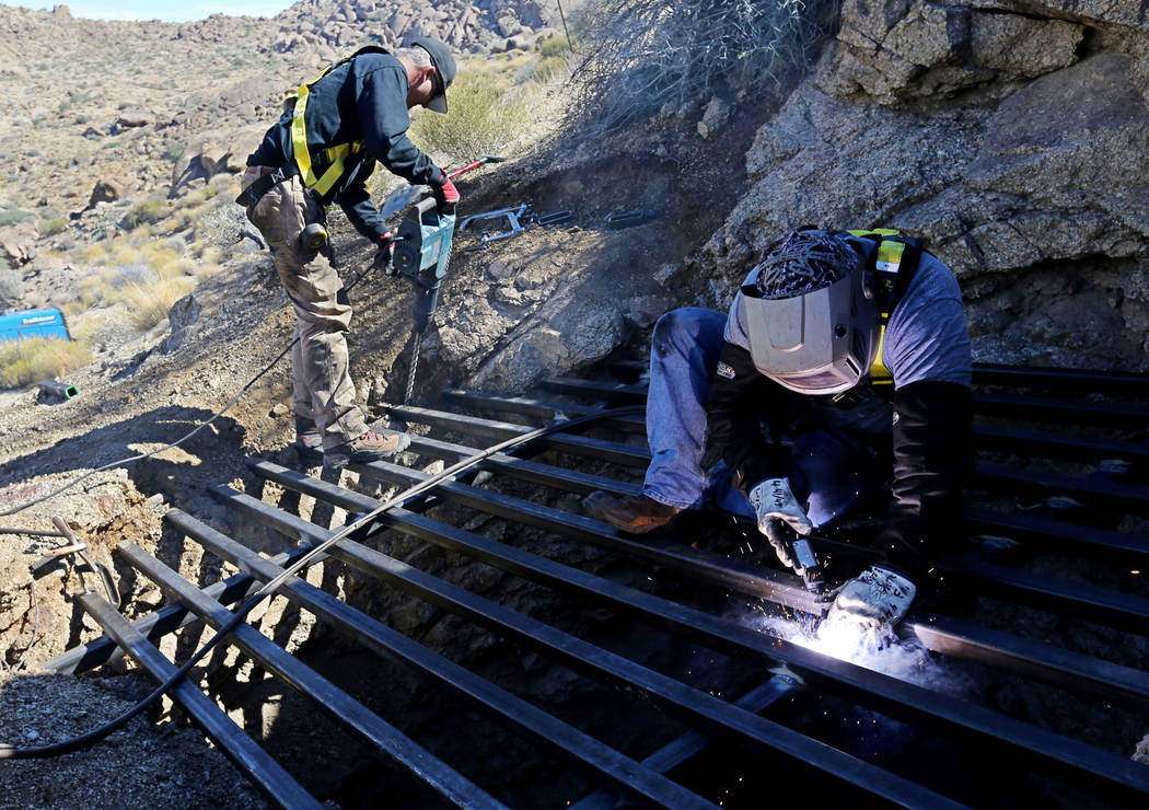 State contractors, Brian Breiter, left, and James Ryan secure steel across the opening of an abandoned mine in Gold Butte National Monument Monday, Oct. 8, 2018. The team is closing off 42 abandon ...