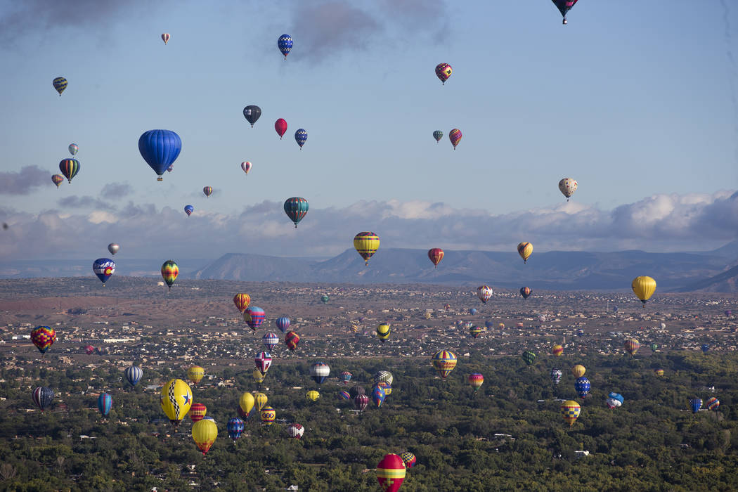 Hot air balloons take part in a flying competition during the 47th annual Albuquerque International Balloon Fiesta in Albuquerque, New Mexico on Monday, Oct. 8, 2018. Richard Brian Las Vegas Revie ...